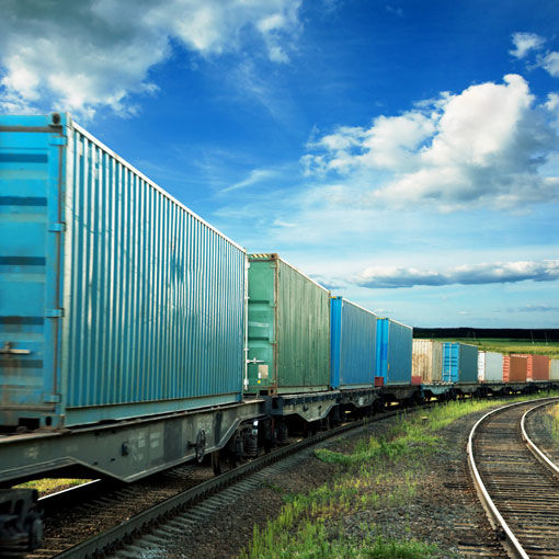Train with rail cars loaded with containers